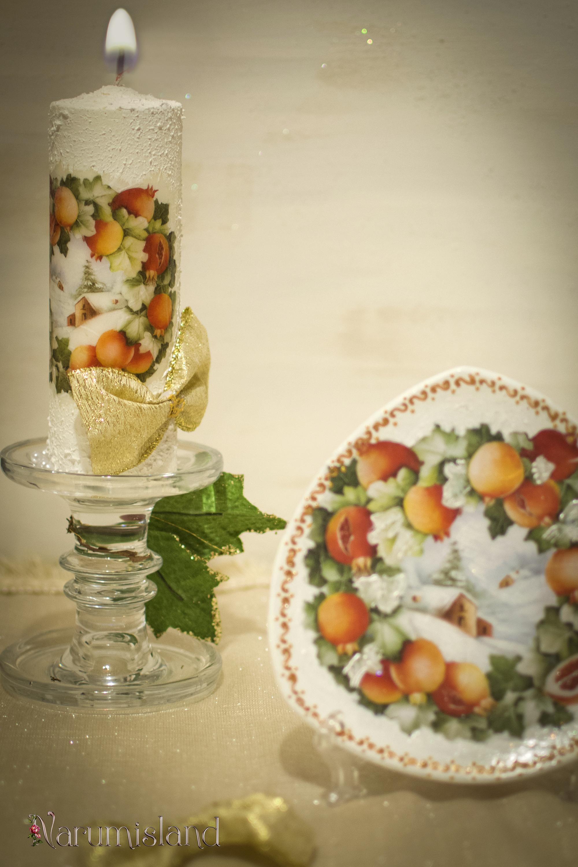 Decor de Craciun: lumanare si farfurie cu fructe